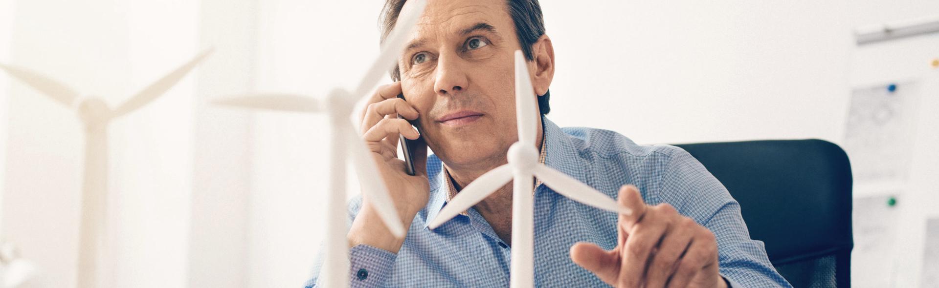 An Alterric employee talks to a customer